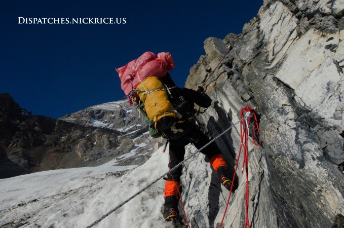 A Sherpa descending from Camp I via the overhanging rock wall loaded down with equipment