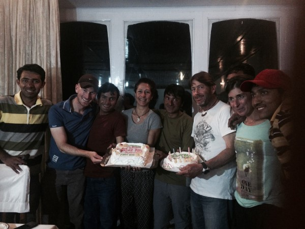 Babar. Nick, Ibrahim, Lina, Manzoor, Carlos (the birthday boy), Pilar, and Akbar in the K2 Motel in Skardu celebrating a successful expedition and Carlos's birthday