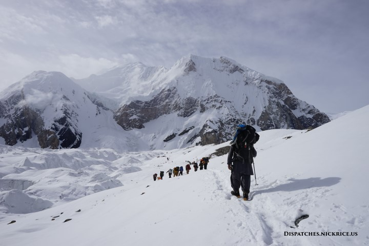 Porters carrying loads toward Gasherbrum Base Camp