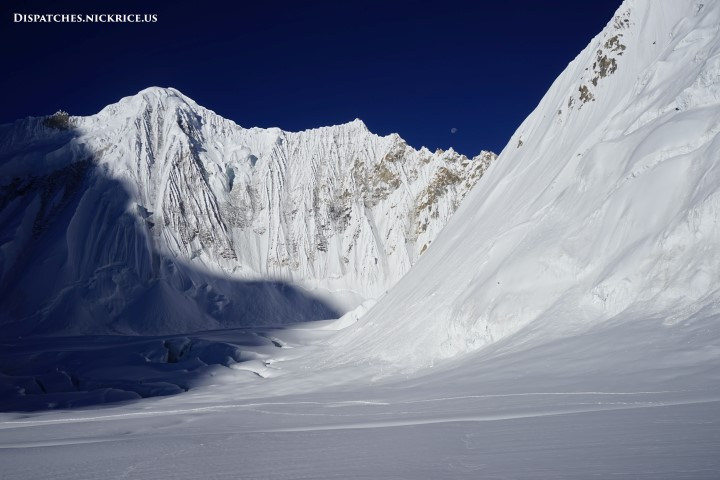Dawn on the Gasherbrum glacier with a massive shadow cast by Gasherbrum I which protected the snow bridges that I must cross when descending through the ice fall.