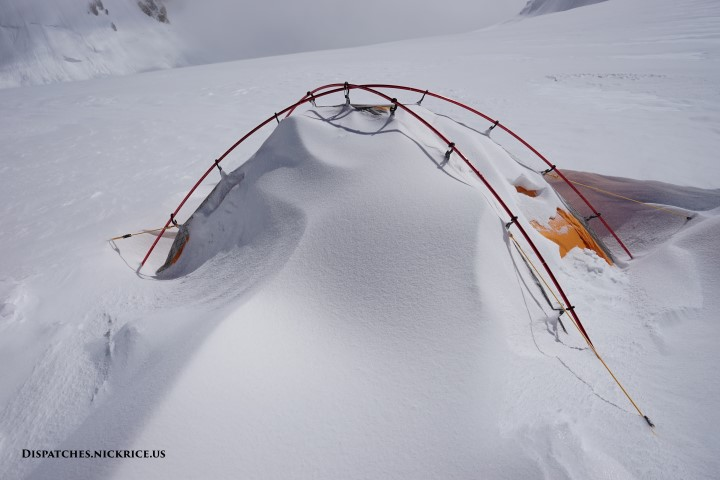 My camp II tent on the last acclimatization cycle after strong winds in the Gasherbrum La (Camp II) buried my tent in spindrift