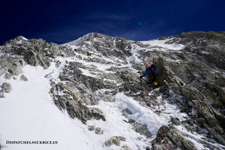 Climbers en route to Camp III along the steep upper rocky ridge of the Japanese Couloir