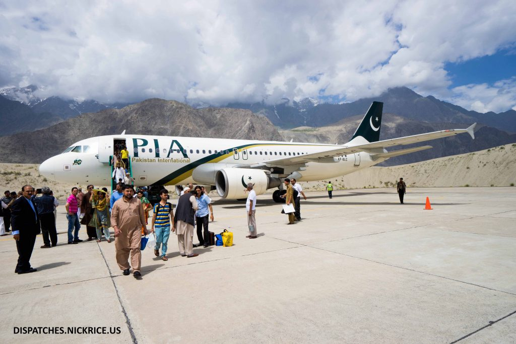 Passengers disembarking from the PIA flight from Islamabad to Skardu