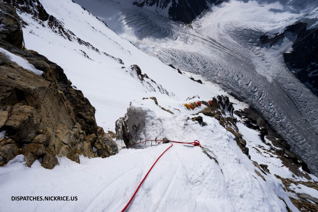 The vertigo-inducing view down House's Chimney (left) of Camp II and the glacier below