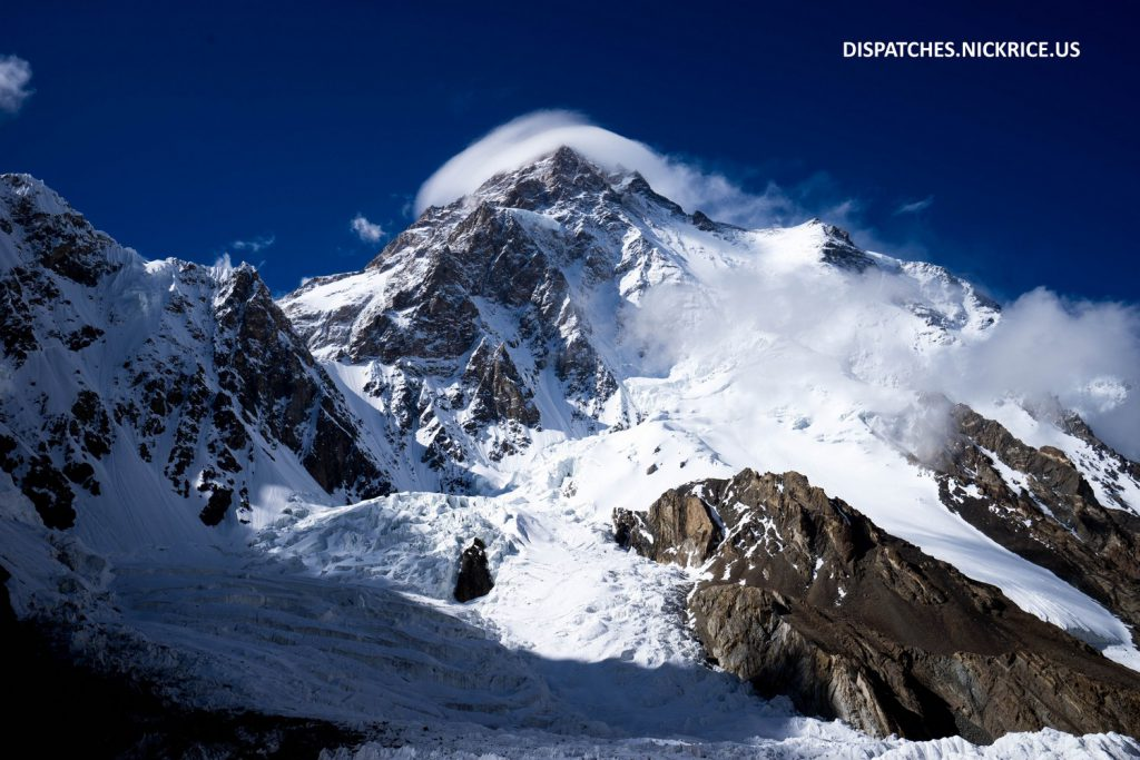 High winds cause the formation of a lenticular cloud on K2 as commercial teams make their way to Camp II
