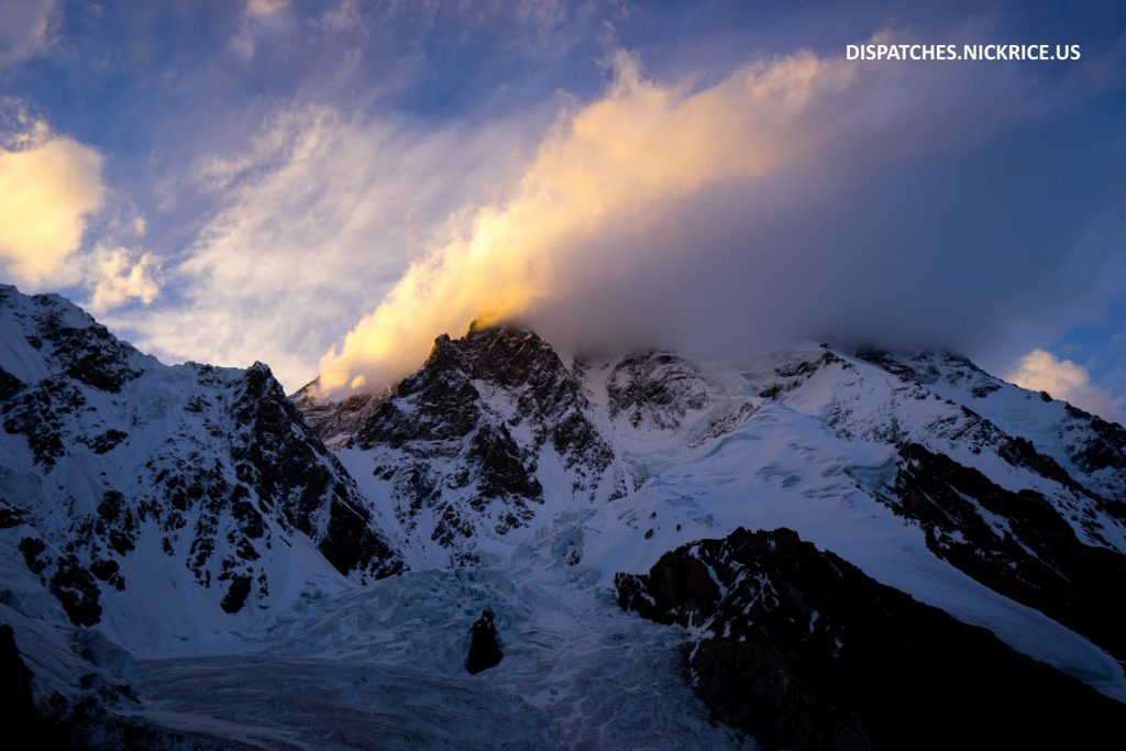 A banner cloud blows off of K2's upper flanks at sunset